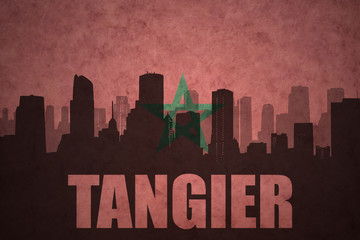 abstract silhouette of the city with text Tangier at the vintage moroccan flag