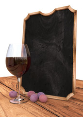 Chalkboard with grapes and wine on wood table, isolated on white background, 3d illustration