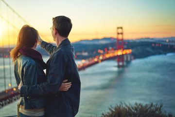 couple taking photo of golden gate bridge