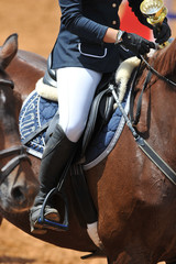 The close-up view of a rider on a horseback