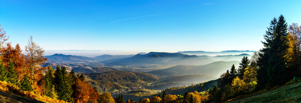 Aerial view of colorful autumnal mountains, foggy sunset