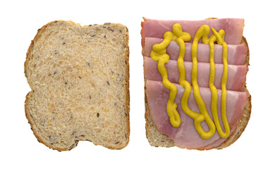 Applewood smoked ham with mustard on bread top view isolated on a white background.