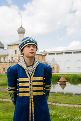 Child in national russian suit on the Kremlin Rostov Great