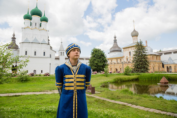 Teen in national russian suit on the Kremlin Rostov Great