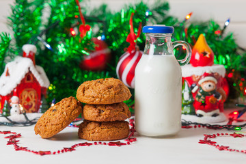 Cookies and milk on christmas background.