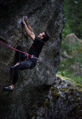 Climber on a cliff. Lead climbing on overhanging cliff. Outdoor extreme sport.