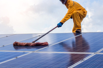 employee man clean of solar cell.