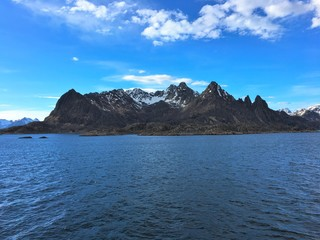 "Beautiful coastal landscape in Lofoten archipelago in Nordland county. The photo is taken from a boat just east of the city of Svolvaer, the ""capital"" of Lofoten."