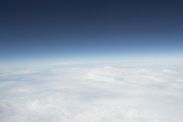 Indigo sky and white clouds