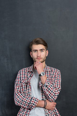 portrait of young startup businessman at modern office, chalkboa