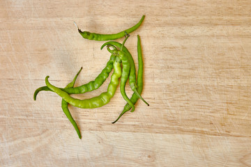 Green papper or guinea-pepper on a wooden background