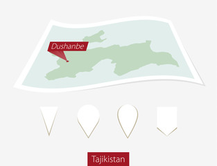Curved paper map of Tajikistan with capital Dushanbe on Gray Background. Four different Map pin set.