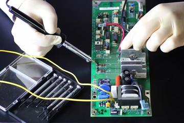 man hands chip soldering tools