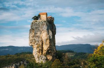 Katskhi pillar. Georgian landmarks. Man's monastery near the village of Katskhi. The orthodox church and the abbot cell on a rocky cliff. Imereti, Georgia. Georgian Meteora Wall mural