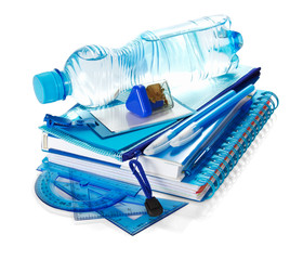 The book, notepad, stationery and water bottle isolated on white.