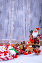 Christmas still life decorations with fluffy toy animals and Santa