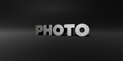 PHOTO - hammered metal finish text on black studio - 3D rendered royalty free stock photo. This image can be used for an online website banner ad or a print postcard.