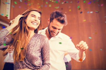Composite image of cheerful young dancing couple