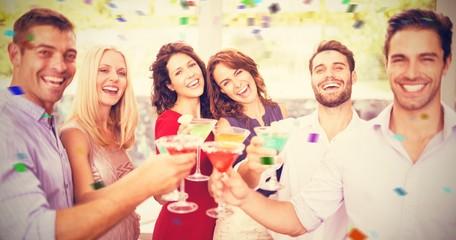 Composite image of portrait of friends having cocktail