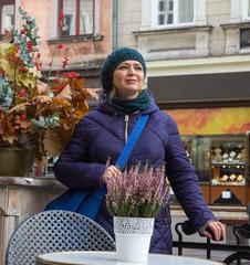Woman in coat walking the autumn city