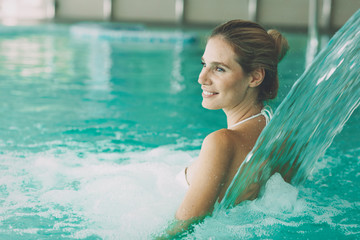 Beautiful woman in spa pool