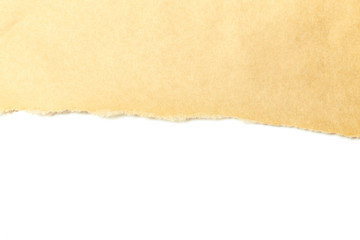 Brown package paper torn to reveal white panel