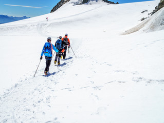 Mountaineers walking on the summit of Mont Blanc