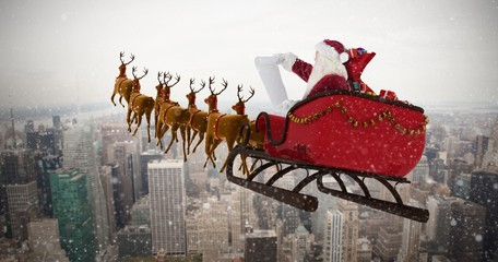 Composite image of santa claus riding on sled during christmas