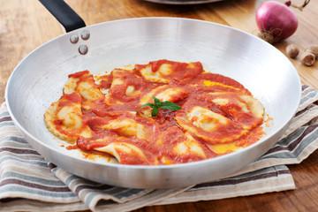 Mezzelune handmade pasta with tomato sauce