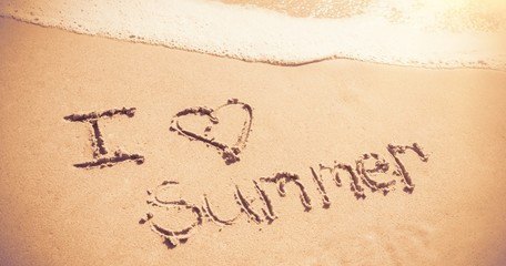 I love summer written on sand