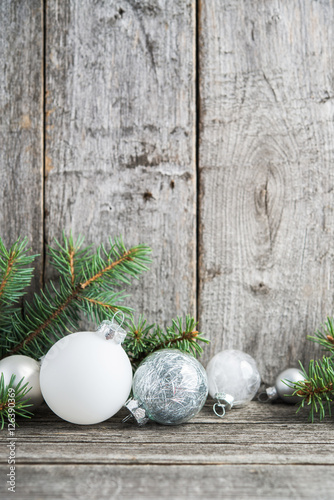 Silver And White Christmas Ornaments Xmas Tree On Rustic Wood Background Merry Card Winter Holiday Theme Happy New Year Space For Text