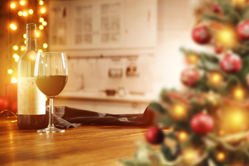 xmas background of kitchen interior and wooden table with wine
