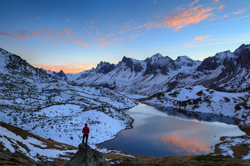 Fotomurales - Woman looking over Lac Long, in the Claree valley, France, during a colorful sunset.