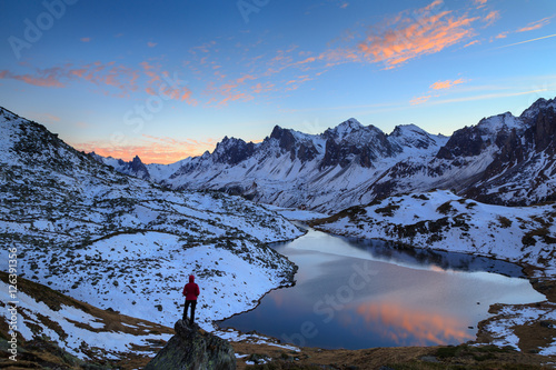 Fotomurales Woman looking over Lac Long, in the Claree valley, France, during a colorful sunset.