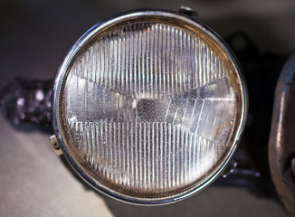 Closeup photo of old car headlight