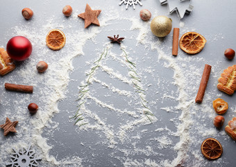Christmas tree made of flour and natural decor on grey table