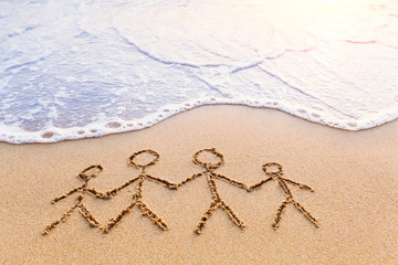 Symbol of family drawn in the sand, parents, children, together