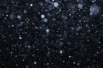 "Real falling snow on a black background for use as a texture layer in your project. Add as ""Lighten"" Layer in Photoshop to add falling snow to any image. Adjust opacity to taste."