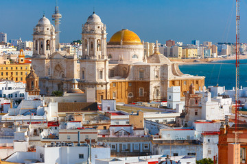 Wall Mural - Aerial view of the old city rooftops and Cathedral de Santa Cruz in the morning from tower Tavira in Cadiz, Andalusia, Spain