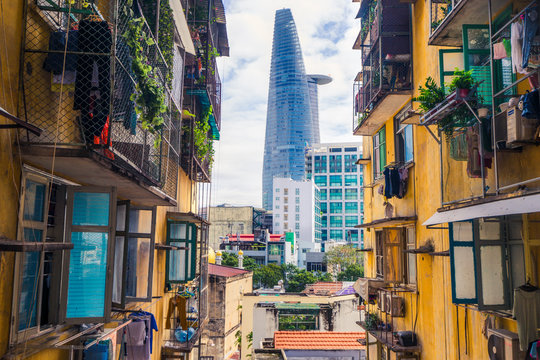 Ho Chi Minh city, Vietnam - October 30th, 2016: Saigon skyscraper from inside an old apartment building.