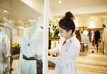 Woman working in fashion boutique
