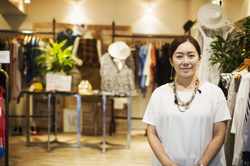 Woman working in a fashion boutique in Tokyo, Japan.