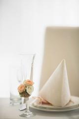 Beautiful wedding decoration on glass in restaurant