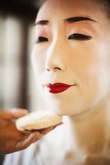 Woman with traditional geisha white make up