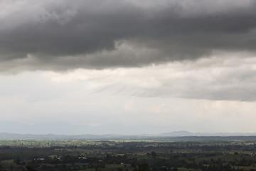 Dusky atmosphere of the farmland in rain storm, Mae Sot, Tak, Thailand
