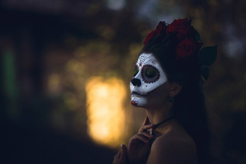 Portrait of a girl with scary artistic Halloween make-up outside