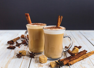 Two cups of cappuccino, anise and cinnamon