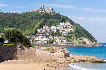 Fototapeta premium View to Igeldo, a quarter of San Sebastian. It is a small town located at the hillside of the same name towering over the west side of the Bay of La Concha one of the famous urban beaches in Europe