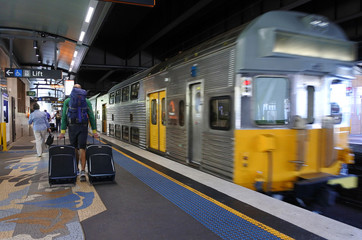 Passengers get off Sydney Trains at Circular Quay station in Syd