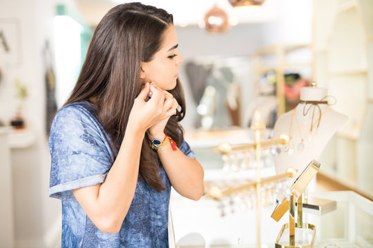 Young woman looking to buy some earrings